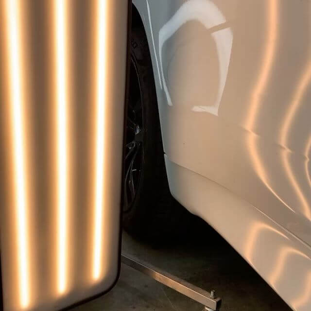 light on paint to check dents